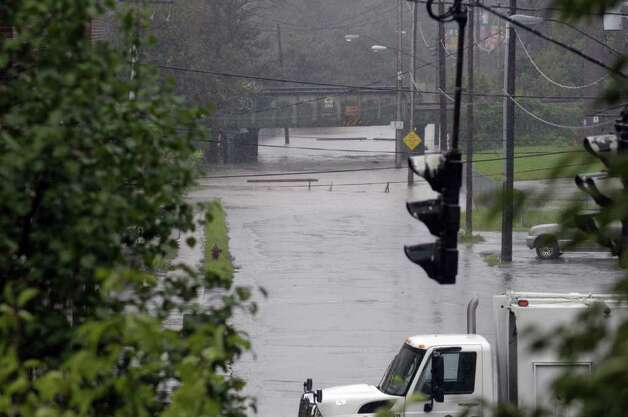 Weaver Street off Broadway is flooded as Tropical Storm Irene hit the Capital Region on Sunday, Aug. 28, 2011, in Schenectady.  (Paul Buckowski / Times Union) Photo: Paul Buckowski / 00014427A
