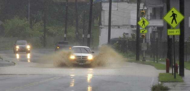 A vehicle is driven through a flooded section of Broadway as Irene hit the Capital Region on Sunday, Aug. 28, 2011 in Schenectady.  (Paul Buckowski / Times Union) Photo: Paul Buckowski / 00014427A