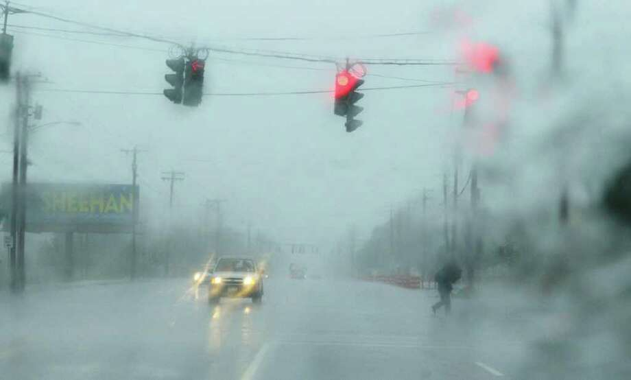 Rain pours down on Central Avenue as Irene hit the Capital Region on Sunday, Aug. 28, 2011 in Schenectady.  (Paul Buckowski / Times Union) Photo: Paul Buckowski / 00014427A