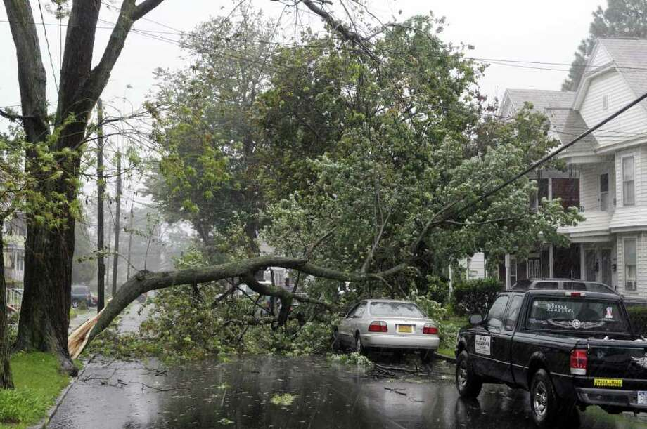A section of a tree fell across Avenue A as Irene hit the Capital Region on Sunday, Aug. 28, 2011 in Schenectady.  (Paul Buckowski / Times Union) Photo: Paul Buckowski / 00014427A