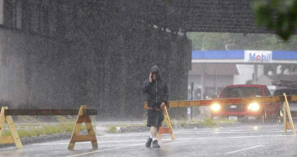 A man ventures out on a closed section of Broadway  as Irene hit the Capital Region on Sunday, Aug.