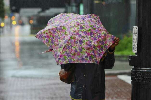 A pedestrian tries to stay dry on North Pearl Street during Hurricane Irene on Sunday Aug. 28, 2011,  in Albany, NY. (Philip Kamrass / Times Union) Photo: Philip Kamrass