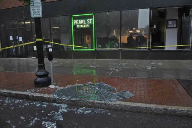 A shattered window lies on North Pearl Street outside of the Pearl Street Diner, broken as a result of Hurricane Irene on Sunday morning Aug. 28, 2011,  in Albany, NY. (Philip Kamrass / Times Union) Photo: Philip Kamrass