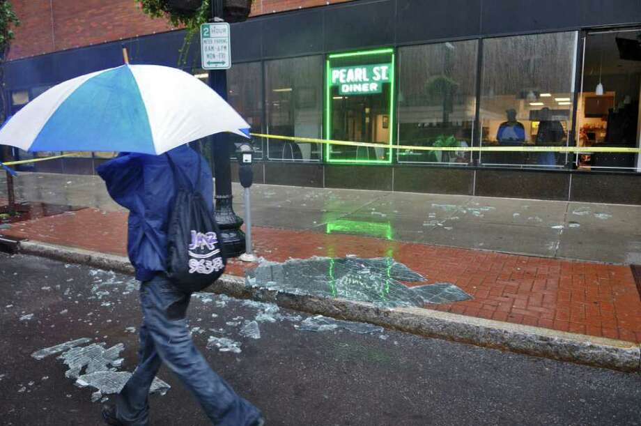 A shattered window lies on North Pearl Street outside of the Pearl Street Diner, broken as a result of Hurricane Irene on Sunday morning Aug. 28, 2011,  in Albany, NY. The pane came from the far right window frame.  (Philip Kamrass / Times Union) Photo: Philip Kamrass