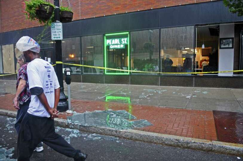 A shattered window lies on North Pearl Street outside of the Pearl Street Diner, broken as a result