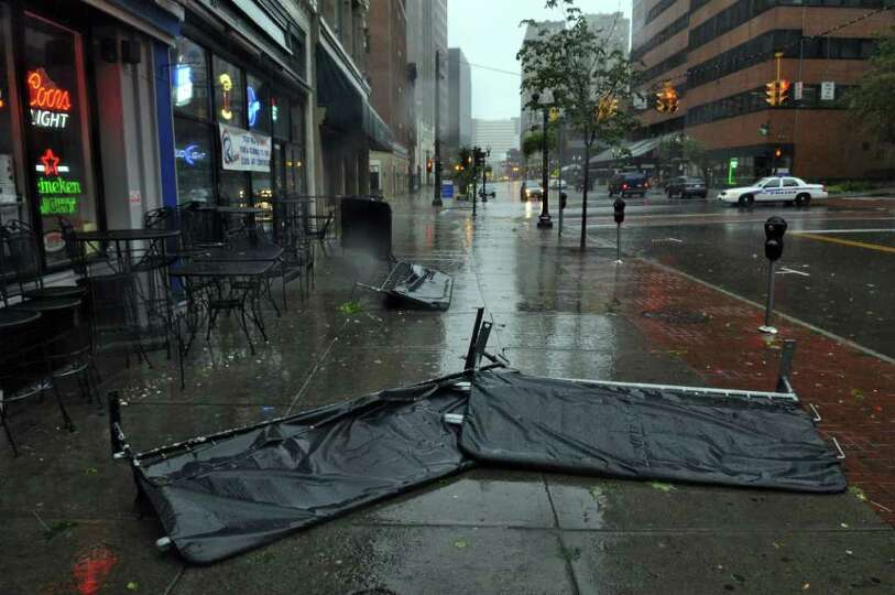 A barrier lies on the sidewalk outside of the R Bar on North Pearl Street during Hurricane Irene on