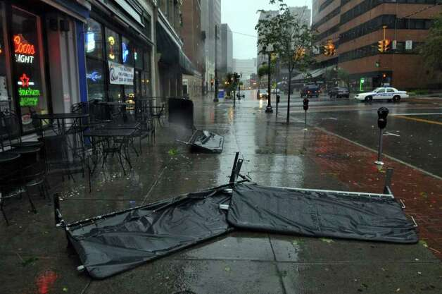 A barrier lies on the sidewalk outside of the R Bar on North Pearl Street during Hurricane Irene on Sunday morning Aug. 28, 2011,  in Albany, NY.  (Philip Kamrass / Times Union) Photo: Philip Kamrass