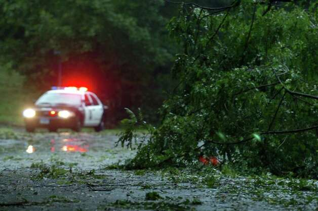 A police car guards traffic near downed trees and power lines on Pumpkin Ground Rd. in Stratford, Conn. Aug. 28th, 2011. Photo: Ned Gerard