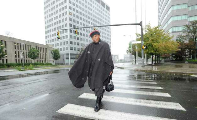 Andy Cason of Stamford walks alone on Tresser Blvd. during Hurricane Irene Sunday morning, Aug. 28, 2011.  Cason said he was going to check on friends. Photo: Bob Luckey / Greenwich Time