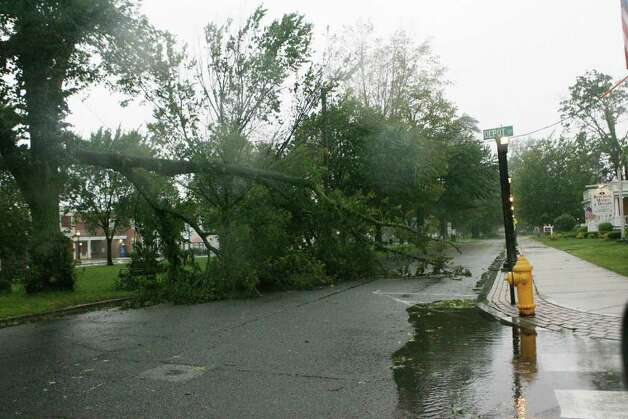 A tree blocks Broadway in downtown Milford as hurricane Irene hits Milford on Sunday August 28, 2011. Photo: B.K. Angeletti / Connecticut Post
