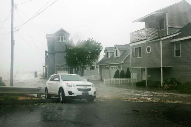 Water covers the road on Melba St. in Milford as hurricane Irene hits Milford on Sunday August 28, 2011. Photo: B.K. Angeletti / Connecticut Post