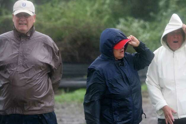 Residents, from left,  Bob Madura, Vi Madura, and Dot Pacella, check out Walnut Beach as hurricane Irene hits Milford on Sunday August 28, 2011. Photo: B.K. Angeletti / Connecticut Post