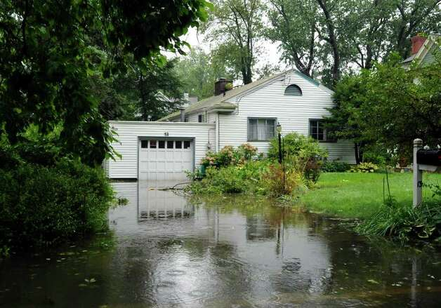 A flooded home on Harding Road in Old Greenwich during Hurricane Irene, Sunday morning, Aug. 28, 2011. Photo: Bob Luckey, Greenwich Time / Greenwich Time