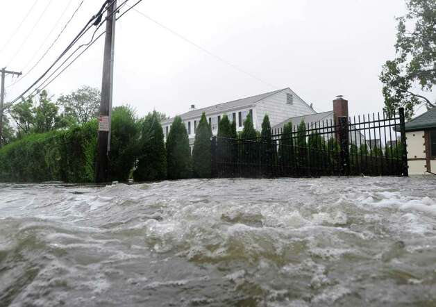 Storm surge water from Long Isalnd Sound rushes down Shore Road in Old Greenwich during Hurricane Irene, Sunday morning, Aug. 28, 2011. Photo: Bob Luckey, Greenwich Time / Greenwich Time