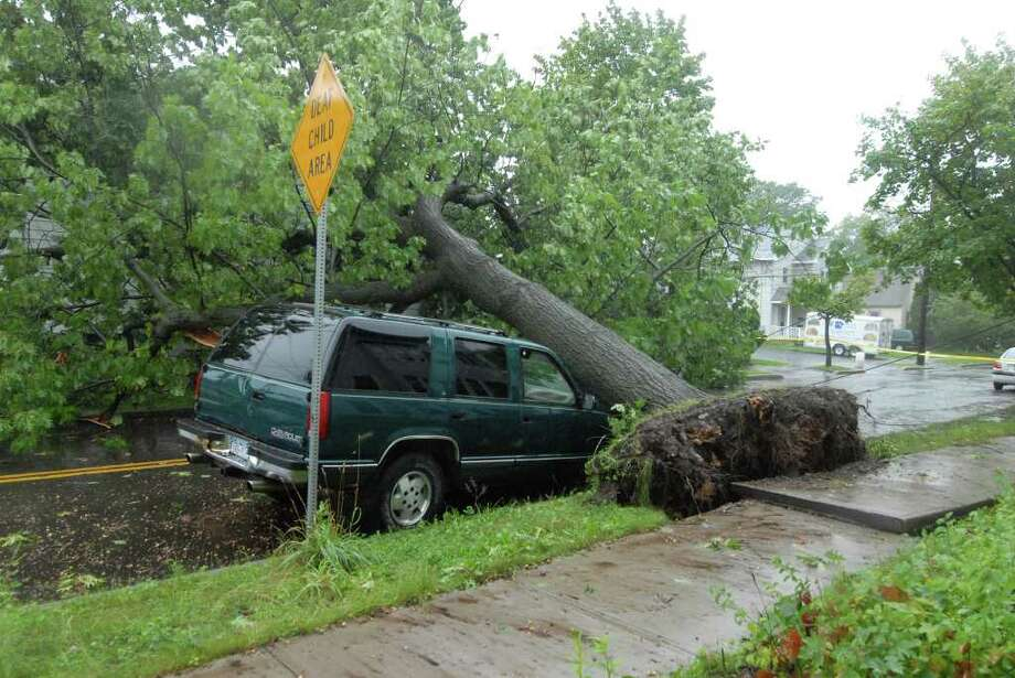 Mereline Avenue in Albany is blocked by a fallen tree Sunday Aug. 28, 2011. Hurricane Irene entered the Capital Region Sunday morning. Emergency personnel spent the day responding to reports of fallen trees, flooding basements, and damaged utility lines. (Will Waldron / Times Union) Photo: Will Waldron