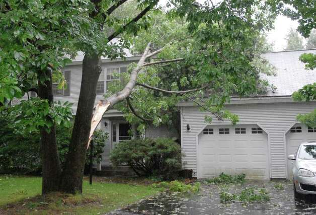 Scenes of fallen branches were an all-too-common site in Delmar, N.Y., Sunday, Aug. 28, 2011. Tropical Storm Irene entered the Capital Region Sunday morning, downing trees and flooding basements throughout the Capital Region. (Will Waldron / Times Union) Photo: Will Waldron