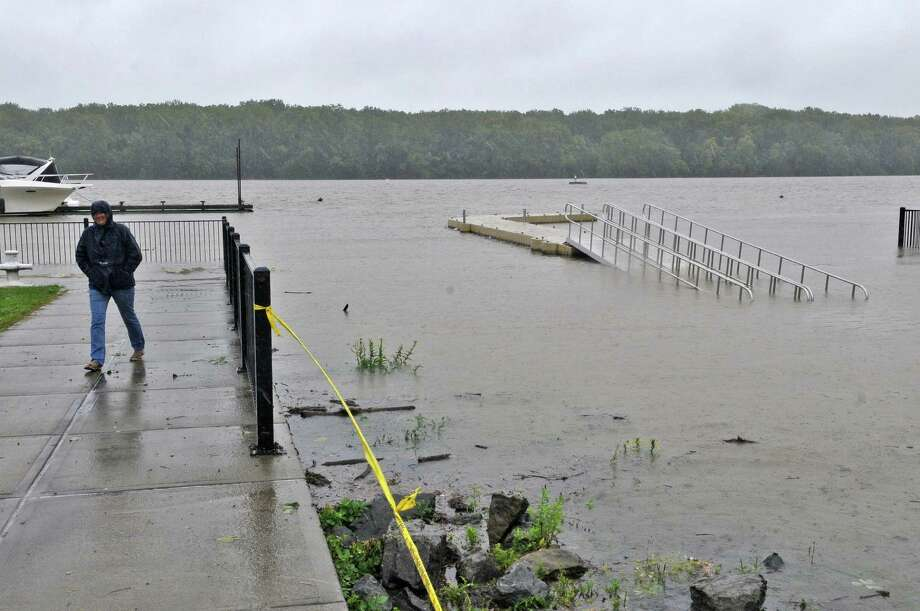 Sheryl Zenzen of Seneca Lake looks over the height  of the Hudson River as a result of Tropical Storm Irene on Sunday Aug. 28, 2011,  in Coeymans Landing, NY.   She had taken her boat from the river yesterday, following a trip down. (Philip Kamrass / Times Union) Photo: Philip Kamrass