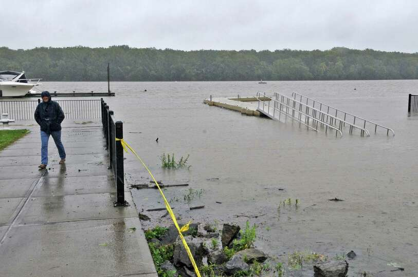 Sheryl Zenzen of Seneca Lake looks over the height  of the Hudson River as a result of Tropical Stor