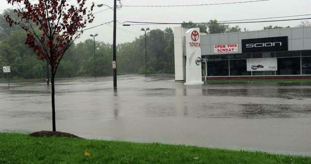 The parking lot of Greentree Toyota in Danbury is completed flooded Sunday morning, the result of heavy rains from Tropical Storm Irene. The lot is empty of cars because they were moved to higher ground in anticipation of the storm Photo taken Sunday, August 28, 2011. Photo: Carol Kaliff