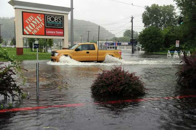 A truck cuts through the road to Home Depot to bypass a blocked section of a fllooded Federal Road in Danbury Sunday, the result of Tropical Storm Irene. Photo taken Sunday, August 28, 2011. Photo: Carol Kaliff
