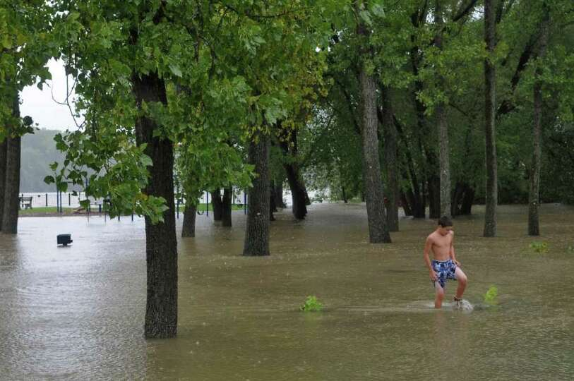 UPDATED CAPTION -Cory Smith of Coeymans Landing, 14 checks the depth of water near a parking lot at