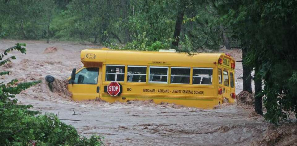A bus is partially submerged by rushing water in Windham where Tropical Storm Irene dumped more than