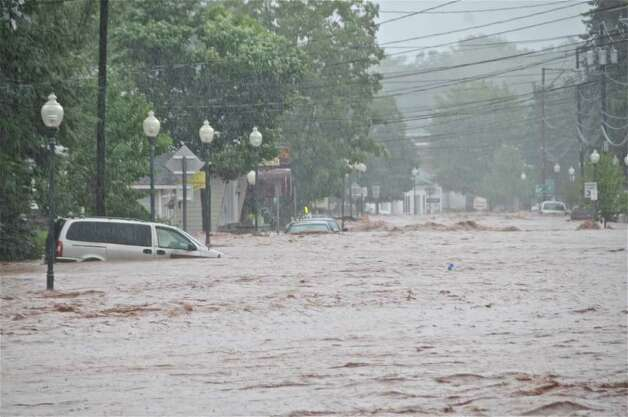 Flood waters rage through Windham on Sunday, Aug. 28, 2011. Tropical Storm Irene dropped 10 inches of rain on the Greene County ski town, causing dramatic damage. (Lance Wheeler / Special to the Times Union.