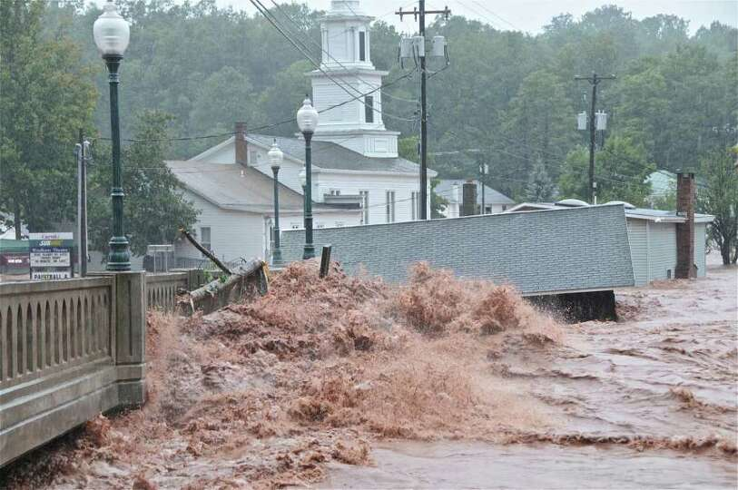 Flood waters smash against a bridge in Windham on Sunday, Aug. 28, 2011, after Tropical Storm Irene