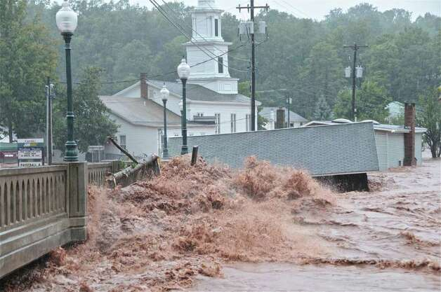 Flood waters smash against a bridge in Windham on Sunday, Aug. 28, 2011, after Tropical Storm Irene dumped 10 inches of rain on the village. (Lance Wheeler / Special to the Times Union)