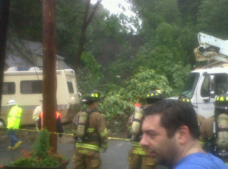Most of a hillside collapsed at Pawling Avenue and Route 2 in Troy as a result of heavy rains from T