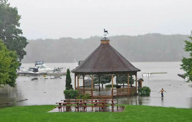 The rising Hudson River reached past the bandstand in the Coeymans Landing park, as a result of  Tropical Storm Irene on Sunday Aug. 28, 2011,  in Coeymans, NY.   The river is normally just beyond the guardrail before the boats at middle left.  (Philip Kamrass / Times Union) Photo: Philip Kamrass