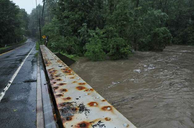 The rising Hannacrois Creek rages under Route 144 on its way to the Hudson River,  as a result of Hurricane Irene on Sunday Aug. 28, 2011,  in Coeymans, NY.   (Philip Kamrass / Times Union) Photo: Philip Kamrass