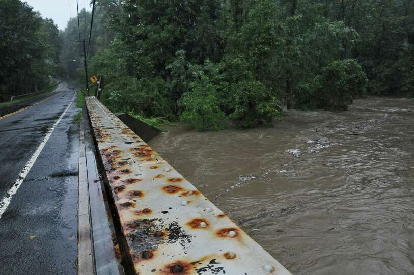 The rising Hannacrois Creek rages under Route 144 on its way to the Hudson River,  as a result of Hu
