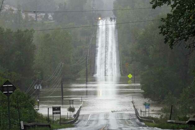Route 9W is overrun by the Coeymans Creek as a result of  Tropical Storm Irene on Sunday Aug. 28, 2011,  in Ravena, NY.   (Philip Kamrass / Times Union) Photo: Philip Kamrass