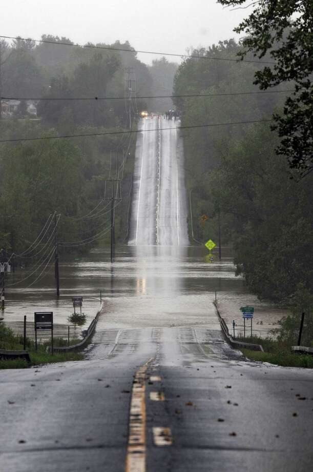 Route 9W is overrun by the Coeymans Creek as a result of Hurricane Irene on Sunday Aug. 28, 2011,  in Ravena, NY.   (Philip Kamrass / Times Union) Photo: Philip Kamrass