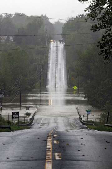 Route 9W is overrun by the Coeymans Creek as a result of Hurricane Irene on Sunday Aug. 28, 2011,  i