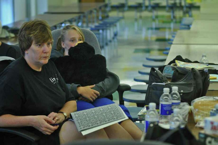 Maureen Perrotte and her daughter, Renee, 13, rest in the emergency shelter in the Ravena Coeymans Selkirk High School, forced out of their town of Coeymans home as a result of Tropical Storm Irene on Sunday Aug. 28, 2011,  in Ravena, NY.   (Philip Kamrass / Times Union) Photo: Philip Kamrass