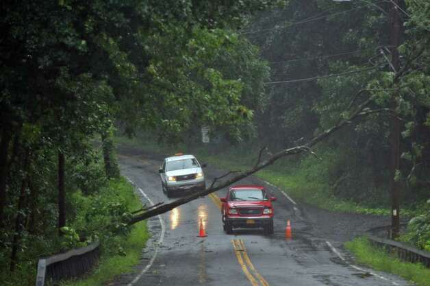 Traffic is stopped by a downed tree on Route 144 near the Hannacrois Creek as a result of Hurricane Irene on Sunday Aug. 28, 2011,  in Coeymans, NY.   (Philip Kamrass / Times Union) Photo: Philip Kamrass