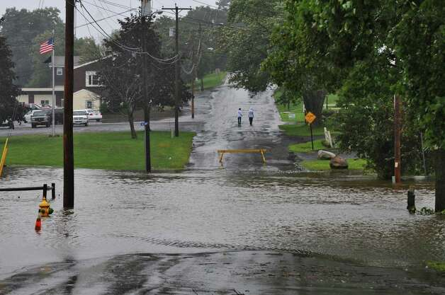 View of flooding on Russell Avenue as a result of  Tropical Storm Irene on Sunday Aug. 28, 2011,  in Ravena, NY.    (Philip Kamrass / Times Union) Photo: Philip Kamrass
