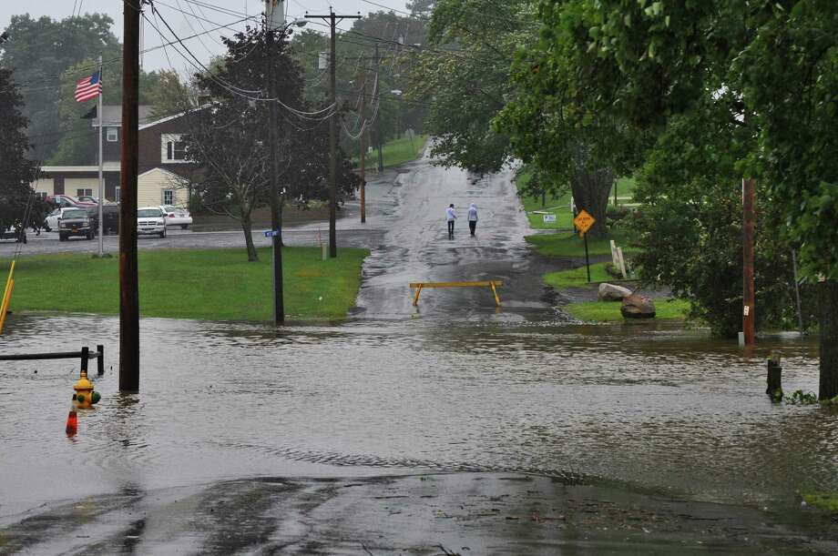 View of flooding on Russell Avenue as a result of Hurricane Irene on Sunday Aug. 28, 2011,  in Ravena, NY.    (Philip Kamrass / Times Union) Photo: Philip Kamrass