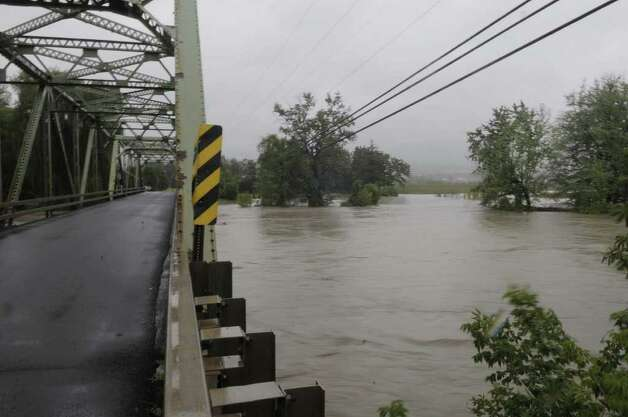 The Schoharie Creek overflowed its banks seen from Bridge St. on Sunday, Aug. 28, 2011 in Schoharie.  (Paul Buckowski / Times Union) Photo: Paul Buckowski, Albany Times Union / 00014427A