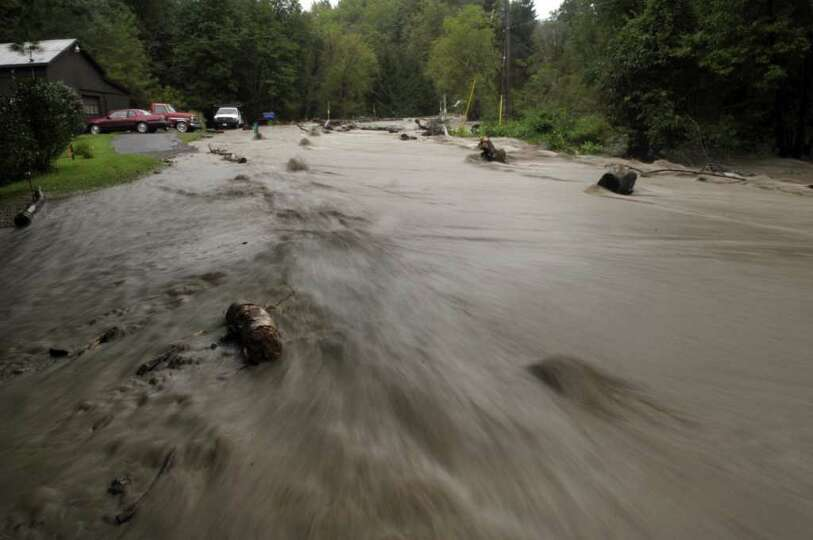 A section of Ecker Hollow Rd. becomes a river as a creek that normally runs under the road overflowe