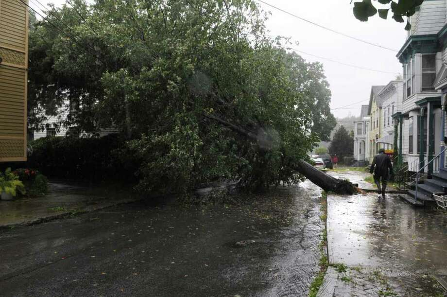 A large tree was toppled on North Ferry Street in the Stockade area as Irene hit the region on Sunday, Aug. 28, 2011 in Schenectady.  (Paul Buckowski / Times Union) Photo: Paul Buckowski / 00014427A