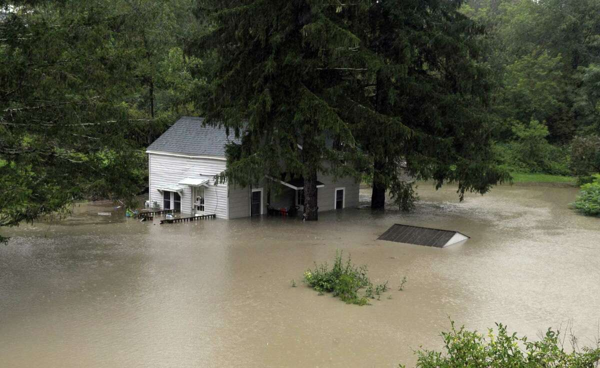 A home on County Route 145 in Middleburgh is surrounded by water as Irene hit the region on Sunday, Aug. 28, 2011. (Paul Buckowski / Times Union)