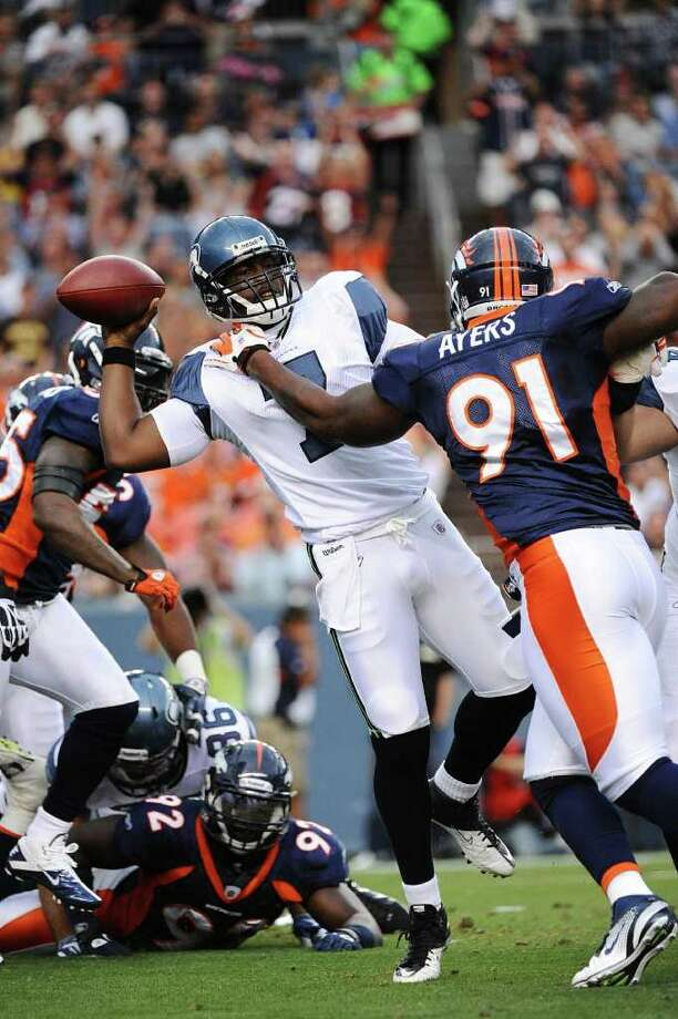 DENVER, CO - AUGUST 27:  Robert Ayers #91 of the Denver Broncos hits Tavaris Jackson #7 of the Seattle Seahawks as he throws a pass during the preseason game at Sports Authority Field at Mile High on August 27, 2011 in Denver, Colorado. Photo: Garrett Ellwood, Getty Images / 2011 Garrett Ellwood
