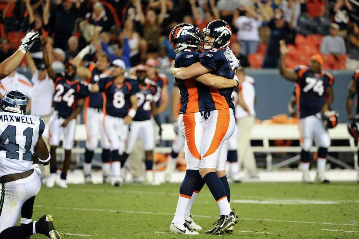 DENVER, CO - AUGUST 27: Steven Hauschka #3 and Britton Colquitt #4 of the Denver Broncos celebrate the game winning field goal during the preseason game against the Seattle Seahawks at Sports Authority Field at Mile High on August 27, 2011 in Denver, Colorado.