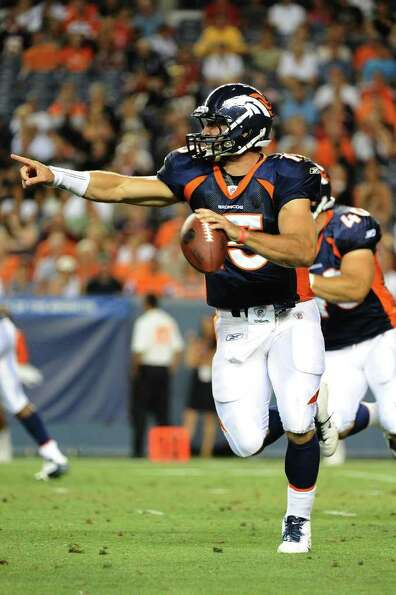 DENVER, CO - AUGUST 27: Tim Tebow #15 of the Denver Broncos runs with the ball during the pre season