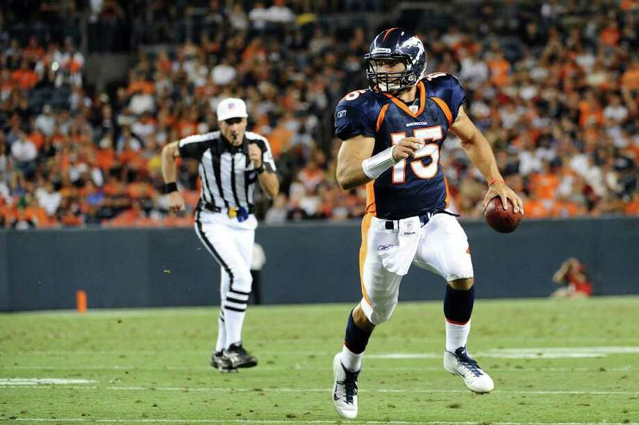 DENVER, CO - AUGUST 27: Tim Tebow #15 of the Denver Broncos runs with the ball during the pre season game against the Seattle Seahawks at Sports Authority Field at Mile High on August 27, 2011 in Denver, Colorado. Photo: Garrett Ellwood, Getty Images / 2011 Garrett Ellwood