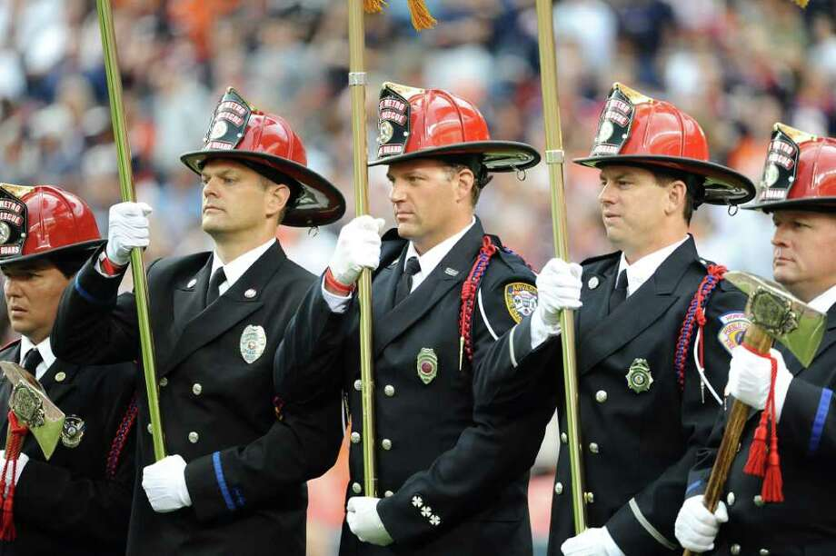 DENVER, CO - AUGUST 27: Fireman stand for the National Anthem prior to the pre season game between the Seattle Seahawks and the Denver Broncos at Sports Authority Field at Mile High on August 27, 2011 in Denver, Colorado. Photo: Garrett Ellwood, Getty Images / 2011 Garrett Ellwood
