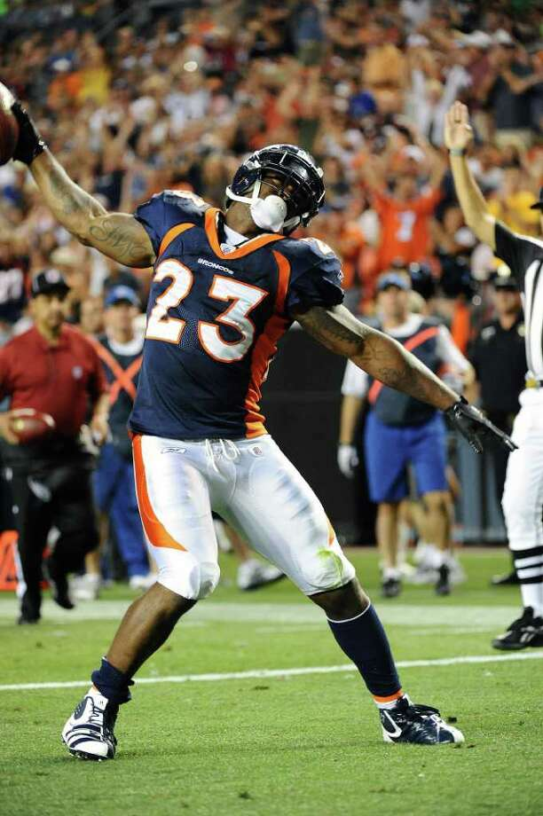DENVER, CO - AUGUST 27: Willis McGahee #23 of the Denver Broncos celebrates his touchdown during the preseason game against the Seattle Seahawks at Sports Authority Field at Mile High on August 27, 2011 in Denver, Colorado. Photo: Garrett Ellwood, Getty Images / 2011 Garrett Ellwood